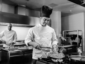 Black and white image of chefs cooking in a kitchen