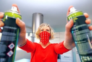 Image of woman holding pest spray bottles