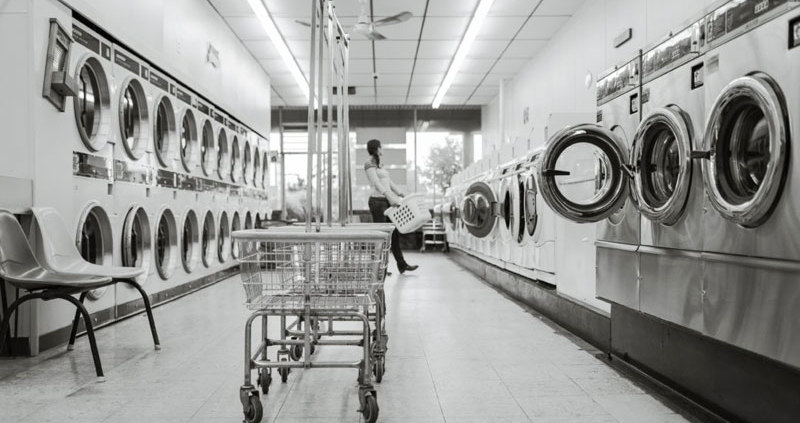 Black and white image of a laundromat