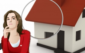 Image of a woman inspecting a house