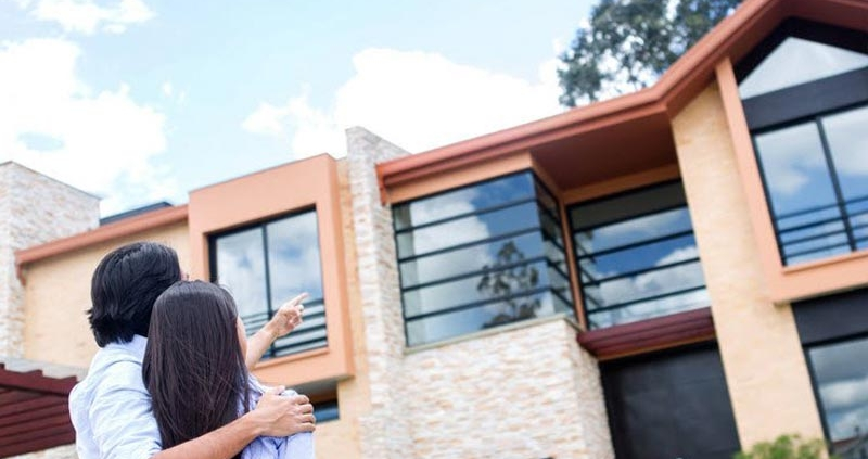 Image of a couple outside a new house