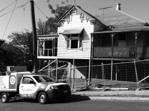 Black and white image of Bob Gunn vehicle in front of a house