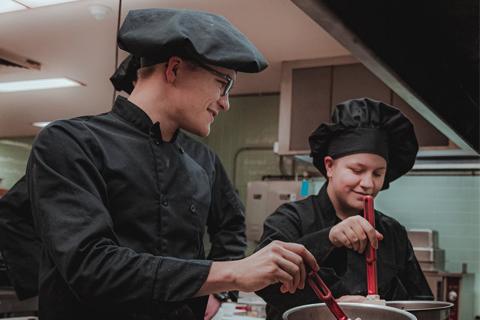 Image of chefs in a restaurant kitchen