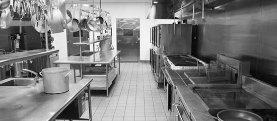 Black and white image of a kitchen
